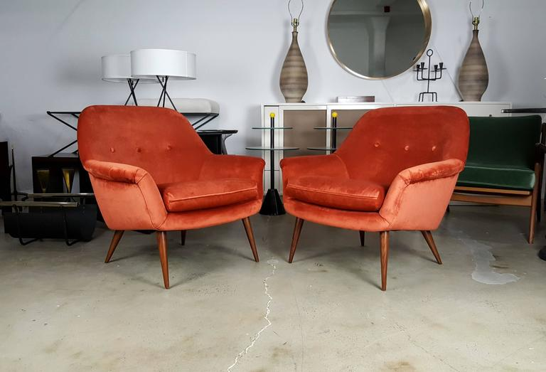 Pair of Italian modern lounge chairs in persimmon velvet. So comfortable and excellent quality.
