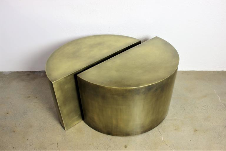Solid brass geometric demilune side tables with heavy patina. Architectural, minimalist design made from the highest quality materials. These tables are contemporary artist-made pieces and were meticulously handcrafted in New England. The antique