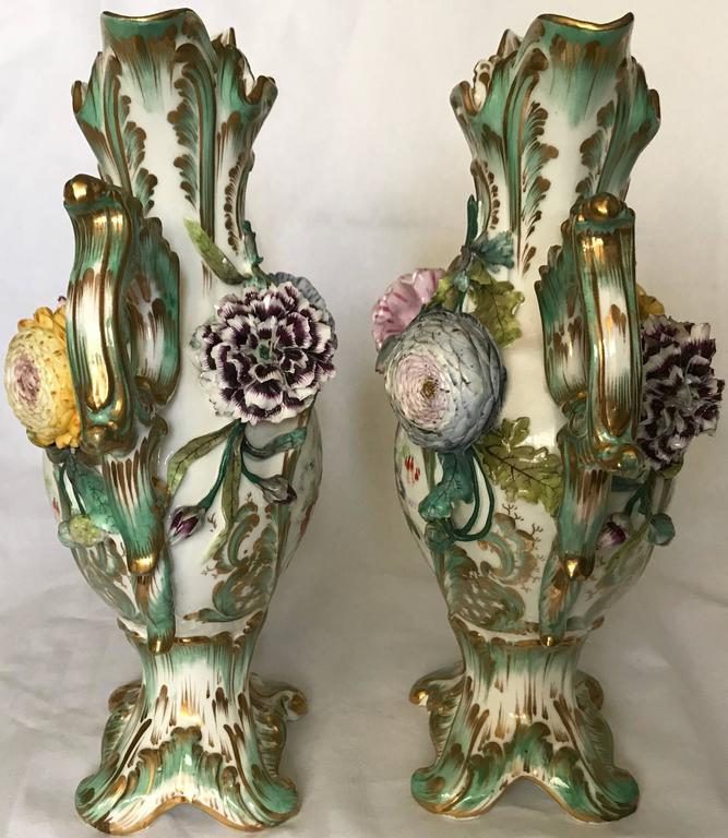 Pair green and gilt painted Rockingham vases.  Pair vases with exceptional figured flowers in excellent condition. England, circa 1840 Dimensions: 8
