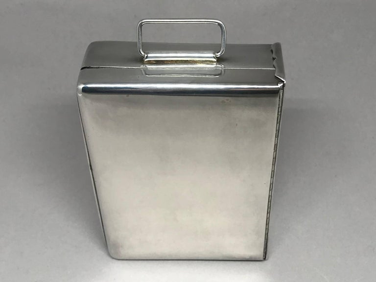 Silver cigarette box. Cigarette box vintage silver plated cigarette box with double-hinged top and handle, United States, mid-20th century. Dimensions: 4.25