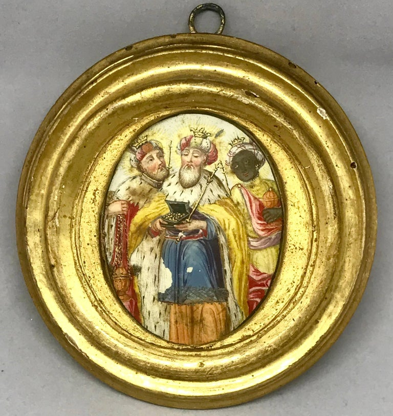 The three kings miniature painting. Antique Louis XV period painting of the three wise men who paid homage to the King. The three kings on card paper in gilt oval frame with original seeded glass and metal hook on the reverse. Beautiful in a
