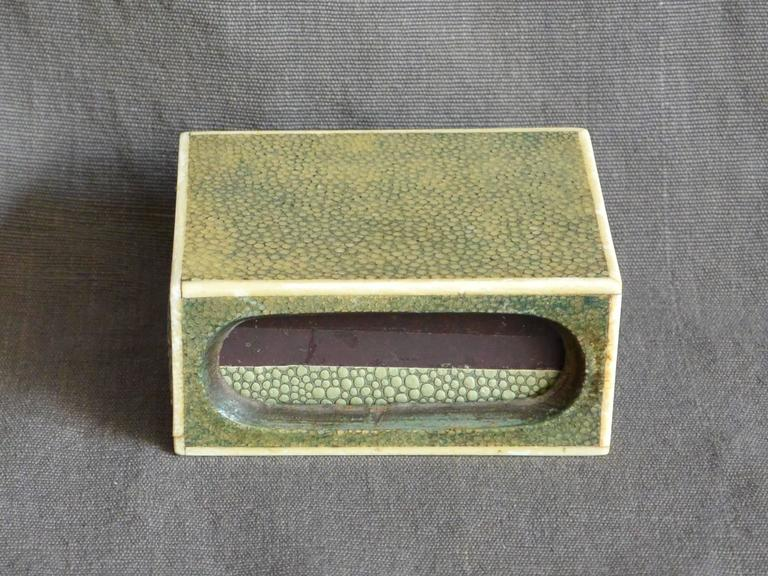 Shagreen match box . Bone trimmed celadon galuchat match box with three strike voids and paper covered match cartridge; a chic little stingray matchbox.  England, early 20th century.  Dimension: 3