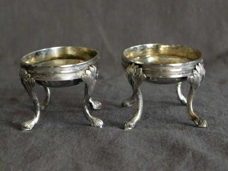 Pair early 19th century Austrian sterling silver oval triple banded and incised salt cellars on foliate legs terminating in hoof feet. Vienna c.1807. Stamps and marks