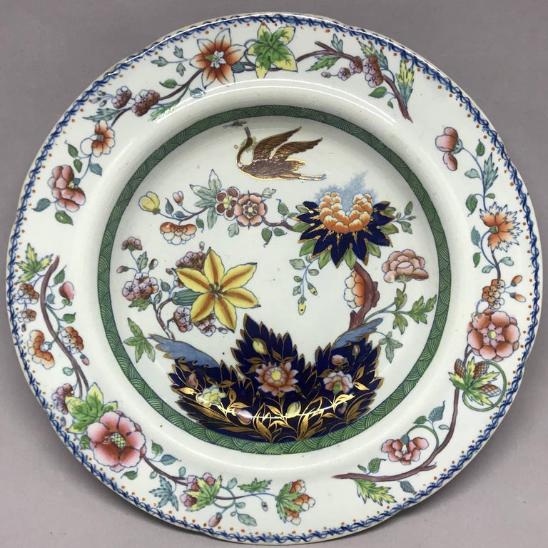 "Davenport chinoiserie plate.  Antique plate with flowers and crane in blues, yellows, greens & gilt outlines. Underglaze blue marks for Davenport Stone China. England, circa 1815.  Dimension: 9.63"" diameter x 1.5"" H."