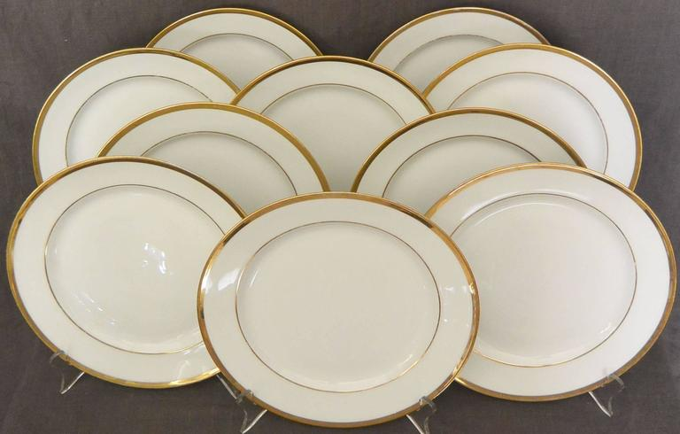 Set of ten white and gilt French Empire plates. Set of ten Empire white and gilt plates with under-glaze red markings for L. Ernie 61 Rue du Bac., France, early 1800.  Diameter: 9.25