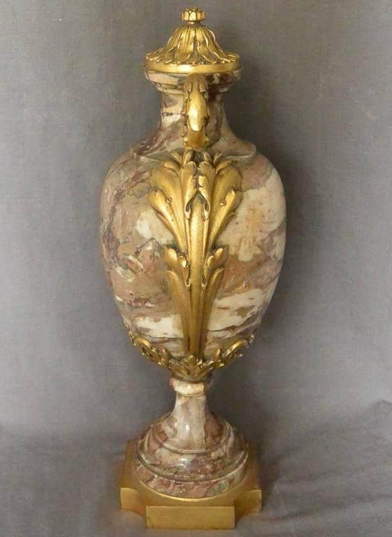 Continental ormolu-mounted marble urn in Napoleon III style with foliate outward scrolling handles and richly chased lid all on incurving square base. Europe, circa 1870
