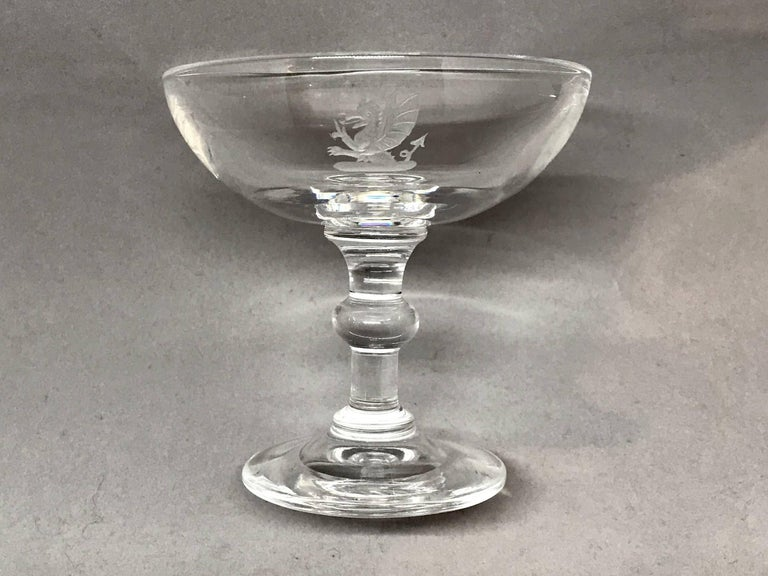 Vintage etched crystal Steuben champagne coupe. Champagne coupe with etched dragon design. Signed