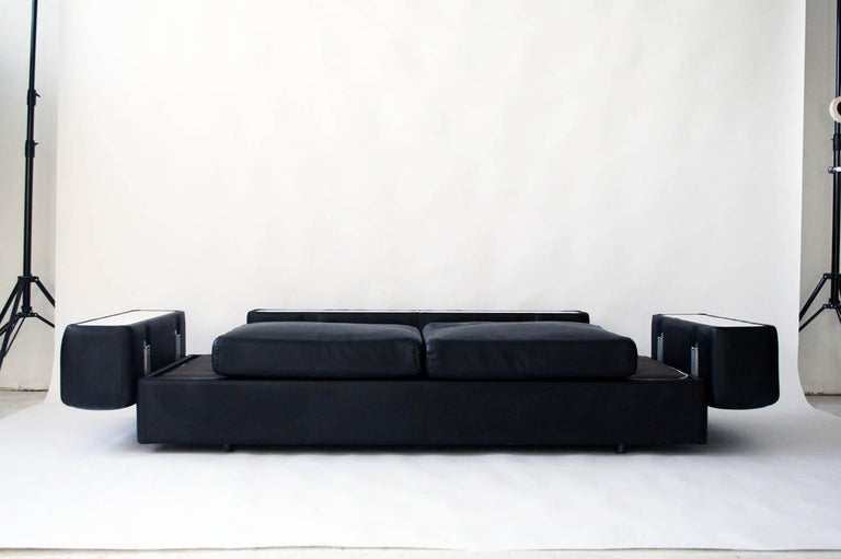 Tito Agnoli for Cinova sofa bed in black leather and steel. Tito Agnoli for Cinova, sofa bed 711 in original black vinyl, Italy, 1960s. The sofa has a wooden interior and features a metal spring seat. A mattress covered with canvas.