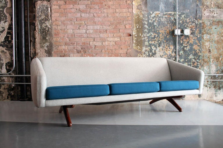 Beautiful iconic design.  Perfect condition. Reupholstered in two-tone felt fabric.