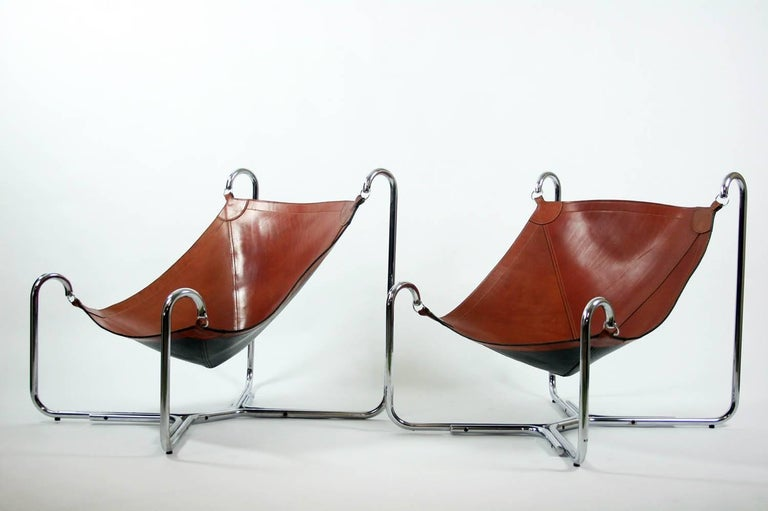 Pair of original vintage Baffo lounge chairs designed in 1969 by Gianni Pareschi and Ezio Didone for Busnelli, Italy. Both chairs are in original leather with beautiful patina.