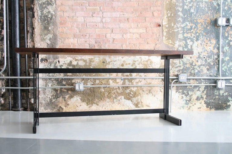 Le Mobilier Universel Belgium, circa 1960 wenge, enameled steel console.