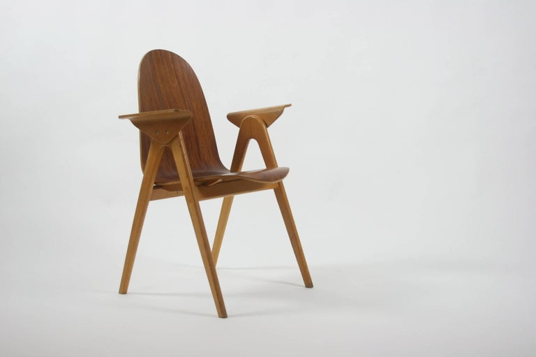 Teak plywood and beech molded chair.