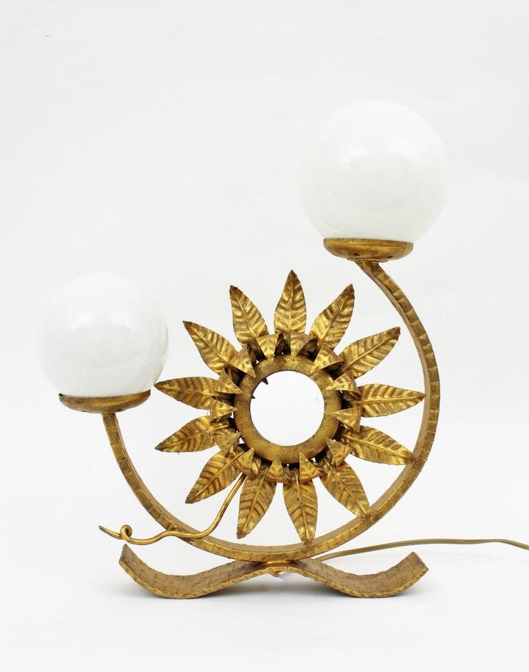 Mid-Century Modern Spanish Gilt Iron Sunflower Sunburst Mirror Table Lamp with Milk Glass Globes For Sale