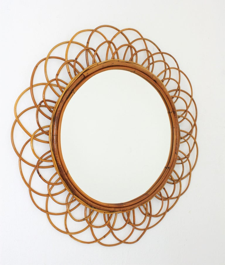 Beautiful handcrafted flower shaped rattan wicker mirror with two layers of cane petals as frame. A piece will all the taste of the Mediterranean French Riviera, beautiful placed alone but also interesting combined with other mirrors in this style