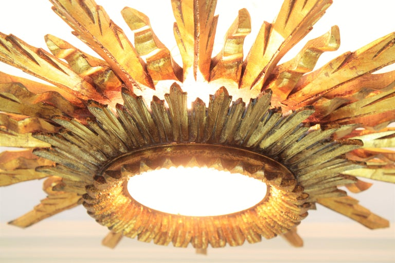Glass Large 1930s Baroque Gold Leaf Giltwood Sunburst Ceiling Light Fixture or Mirror For Sale