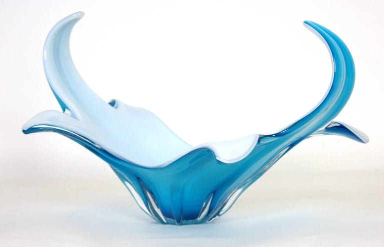 A highly decorative Murano glass centerpiece in a delicate baby blue color. The interior part is made in white opaline glass. This piece is in excellent condition, Italy, circa 1960.
