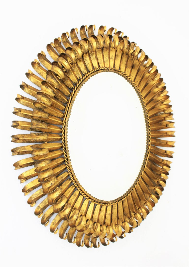 Mid-Century Modern 1950s Spanish Brutalist Hammered Gilt Metal Eyelash Oval Sunburst Mirror  For Sale