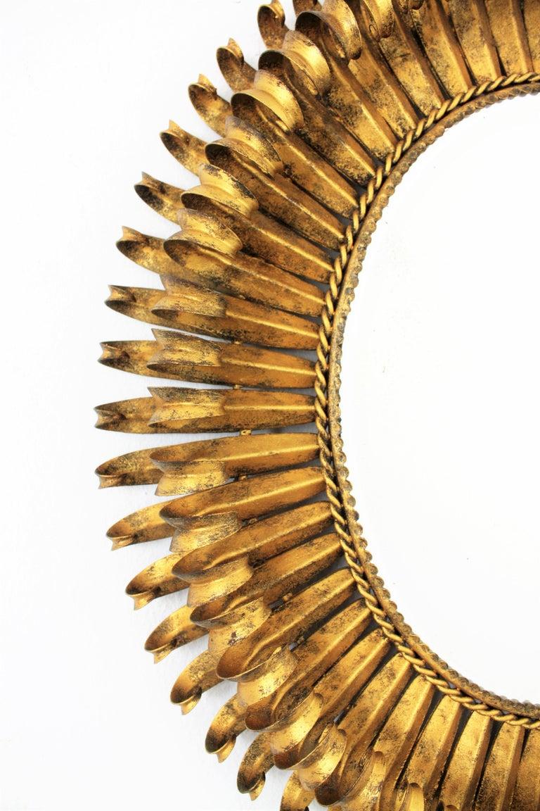 Iron 1950s Spanish Brutalist Hammered Gilt Metal Eyelash Oval Sunburst Mirror  For Sale