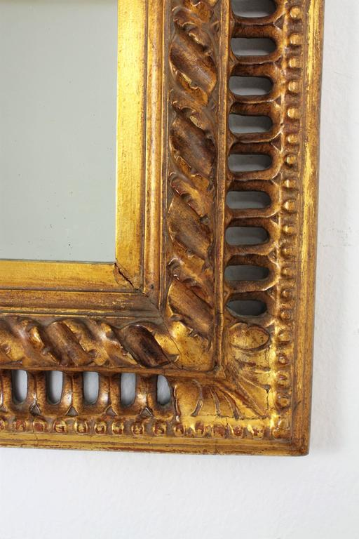 Gold Leaf 19th Century Spanish Baroque Style Giltwood Mirror For Sale