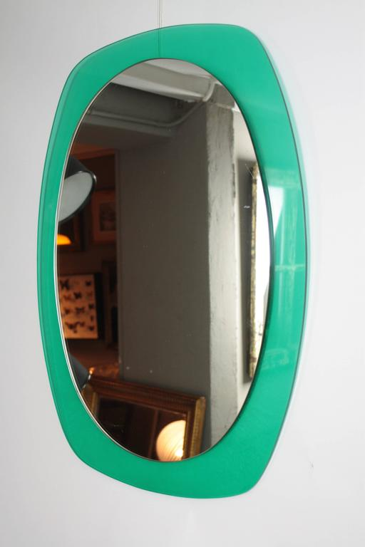 An Italian 1960s colorful aqua green mirror made in Lucite.  The oval mirror measures: H 25.5 inch, W 17.5 inch.  A large collection of mirrors is available in our shop: Please, kindly check our storefront.