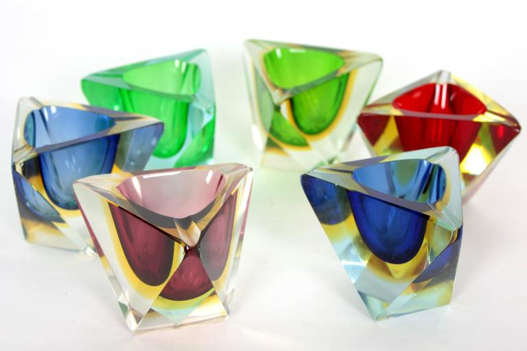 Amazing set of six faceted Sommerso Murano glass ashtrays with unusual triangular shape. Very beautiful to place together or separately. Attributed to Flavio Poli, Italy, 1950s. Individual dimensions: H 7cm, D 8cm, W 9cm.  Available more Murano