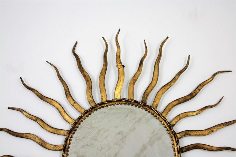 Beveled French 1950s Wrought Gilt Iron Sunburst Mirror in the Style of Gilbert Poillerat For Sale