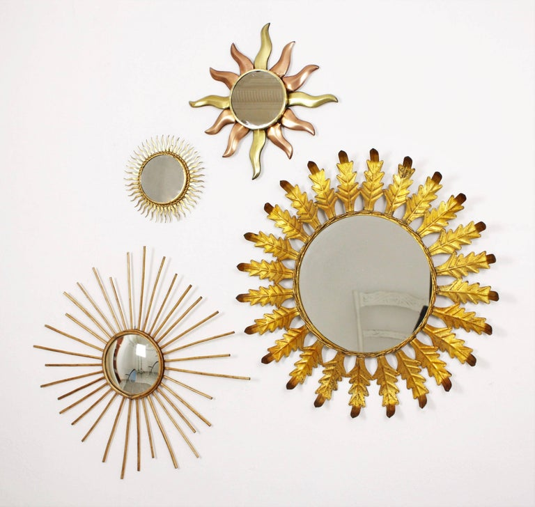 A Lovely Composition With Four Sunburst Mirrors In Diffe Material Chosen From Our Collection Highly