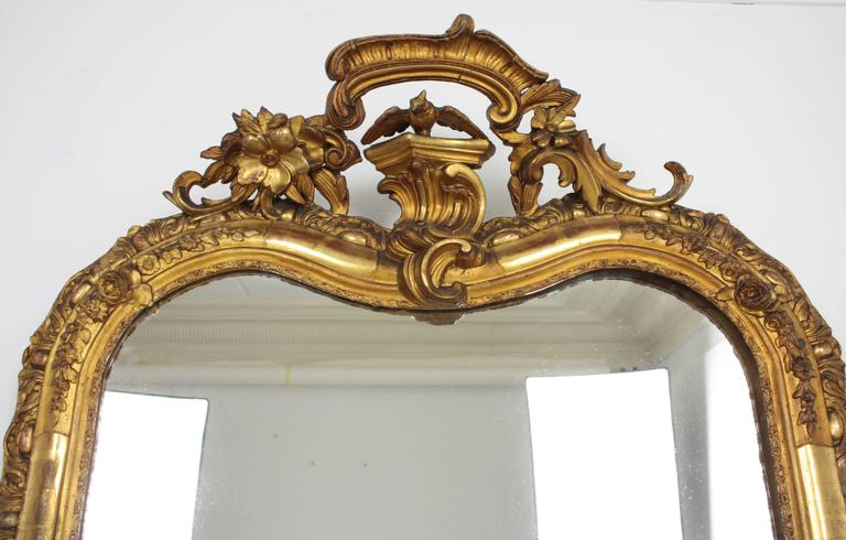 Fine Louis XV period giltwood mirror. Carved wood, covered with gesso and gold leaf finish,