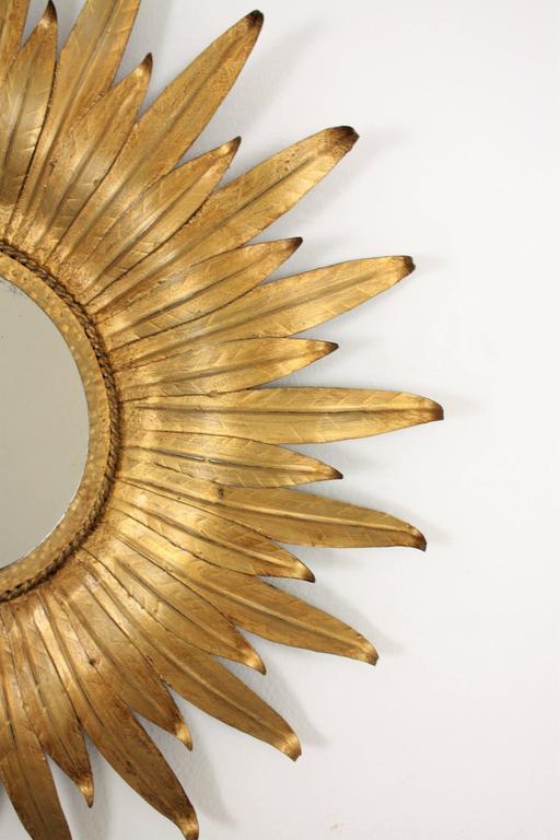 Mid-Century Modern Spanish Gilt Iron Leafed Sunburst Mirror In Excellent Condition For Sale In Barcelona, ES