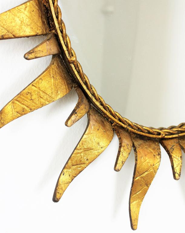 Hammered Mid-Century Modern Wrought Gilt Iron  Oval Sunburst Mirror, Spain 1950s For Sale