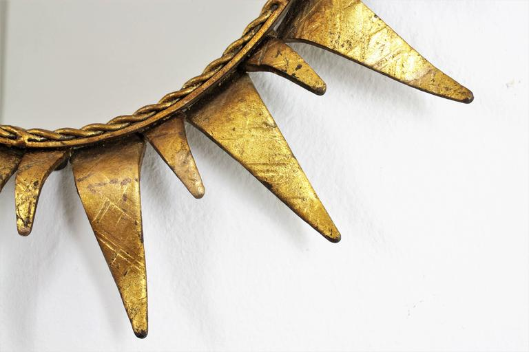 Gold Leaf Mid-Century Modern Wrought Gilt Iron  Oval Sunburst Mirror, Spain 1950s For Sale