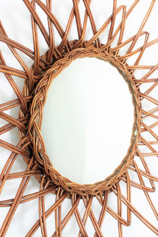 Wicker Spanish 1960s Handcrafted Rattan Starburst or Sunburst Wall Mirror For Sale