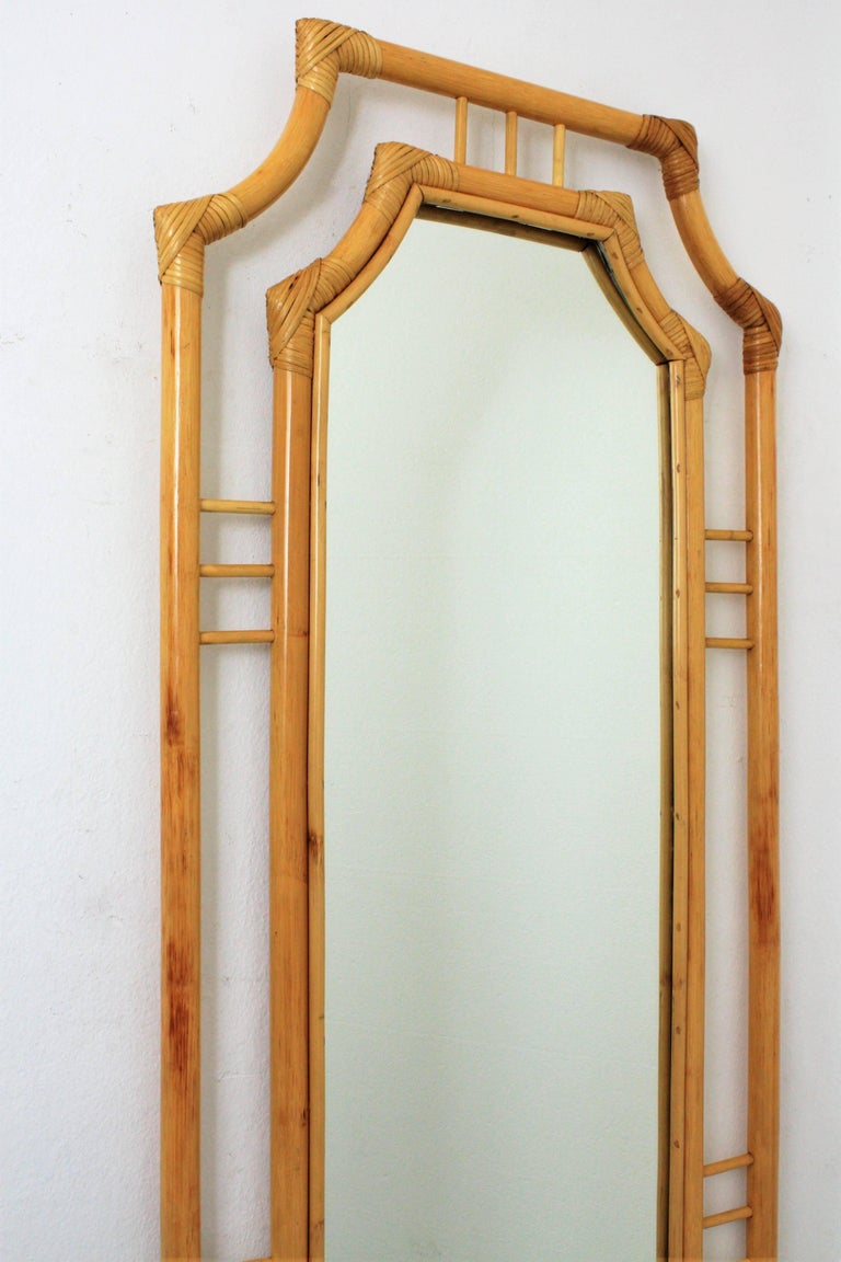 A lovely handcrafted rectangular bamboo mirror with chinoiserie accents on the frame. Spain, 1960s. Glass dimensions: 15cm H; 34cm W.  Avaliable a huge collection of cane mirrors: please kindly check our storefront and Join our profile as 1stdibs