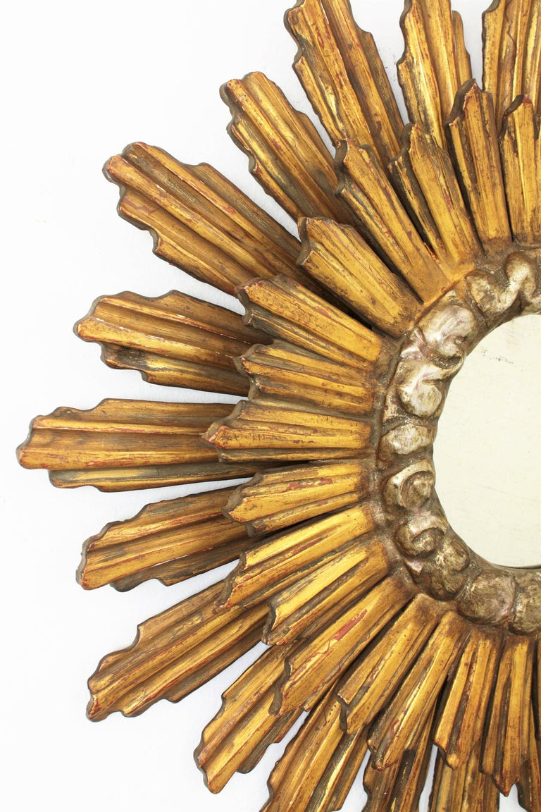 Carved 1930s Baroque Style Double Layered Gold Leaf Giltwood & Silvered Sunburst Mirror For Sale