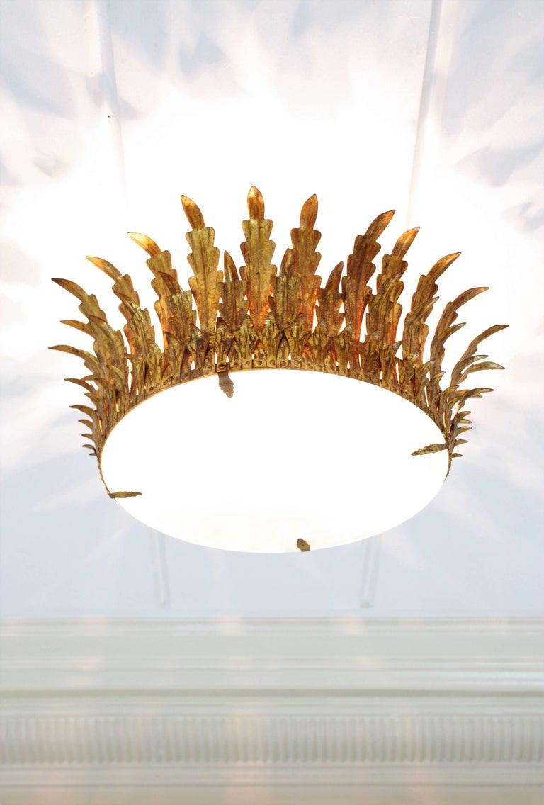 Mid-Century Modern Large Gilt Iron & Glass Sunburst Crown Light Fixture or Chandelier, Spain 1940s For Sale