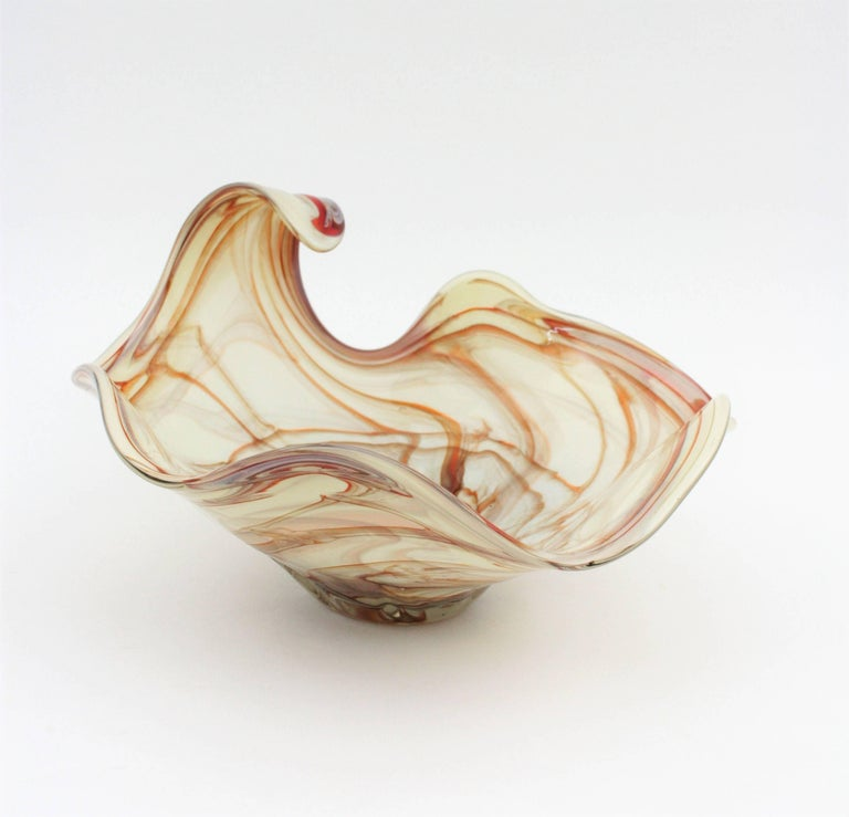 A highly decorative mid-20th century Murano glass centerpiece. Opaline white glass with a decoration with swirls in toffee color cased into clear glass. Very beautiful shapes. Italy, 1960s. This piece is in excellent condition.  Available more