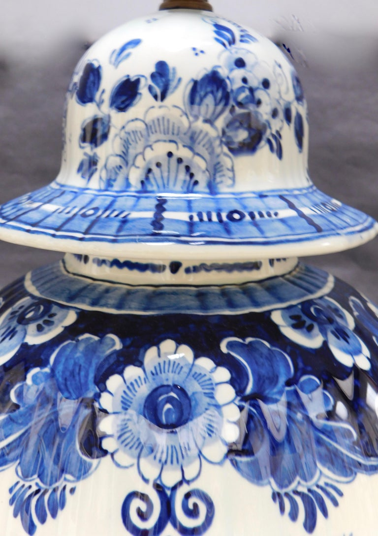 Blue and white dutch delft ceramic vase lamp for sale at 1stdibs a vintage blue and white ceramic delft urn hand painted in delft holland the izmirmasajfo