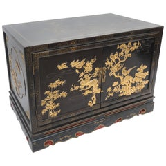 Vintage Black and Gold Lacquered Chinese Export Cabinet