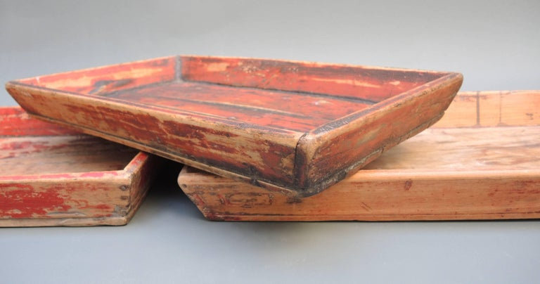 Antique Chinese Provincial trays retaining the original paint and a wonderfully soft worn patina. They are well constructed and as useful and strong today as they were over 100 years ago. The measurement listed is approximate as each tray is