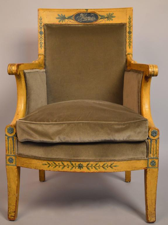 An early 19th century Austrian bergere retaining the original paint. The painted cartouche with a chain of pearls is especially elegant and detailed. The chair has been reupholstered with Dutch cotton velvet and a down cushion.