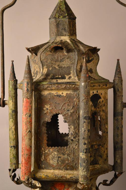 French tole (painted tin) lantern retaining the original paint, circa 1710. Superior workmanship is seen through the use of curved panels in this design instead of easier to execute straight panels. Piercings in the tin allow the light to cast