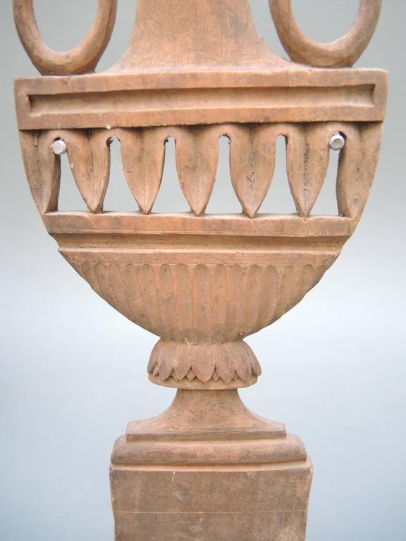 French Directoire period carved wood urn on a custom-made stand.