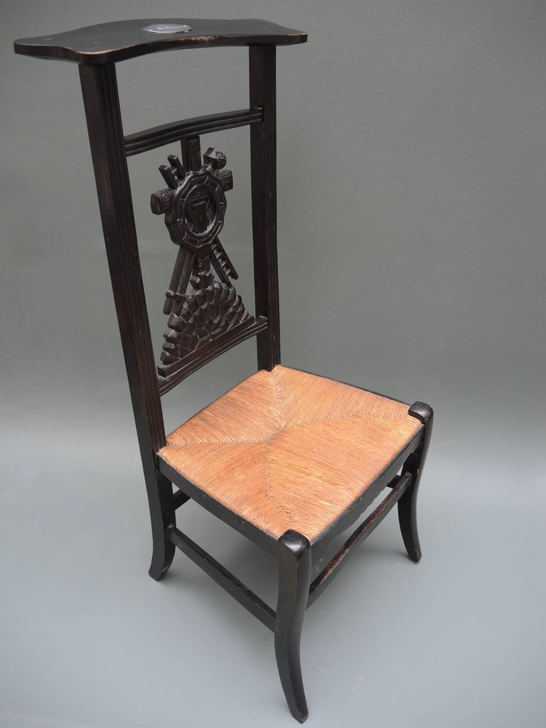 French Provincial prayer chair retaining the original rush seat and paint,  circa 1840. The - 19th Century French Prie-Dieu Prayer Chair With Detailed Carving For