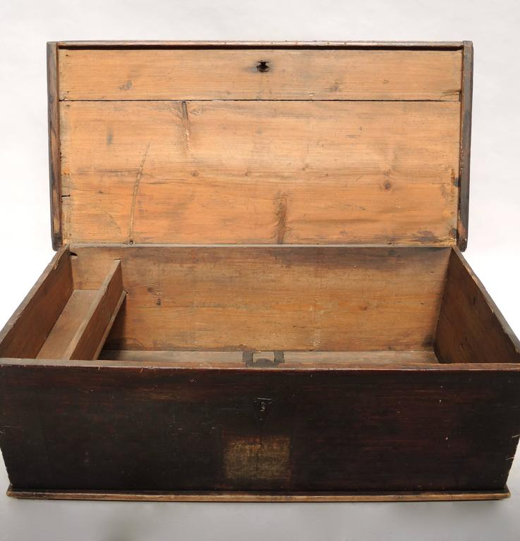 This blanket chest is from the north of Sweden and is hand made using dovetailed joints instead of nails. The dense heavy pine used in construction as well as the dark red, black and yellow simple painted surface pays homage to the no nonsense