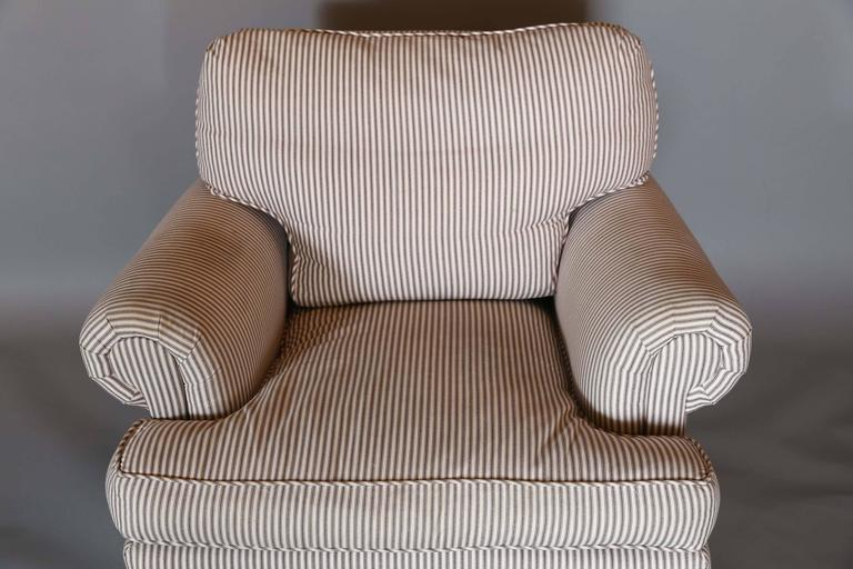 Very Comfortable Chair With Matching Ottoman Upholstered In A Simple  Purplish Brown Ticking Stripe.