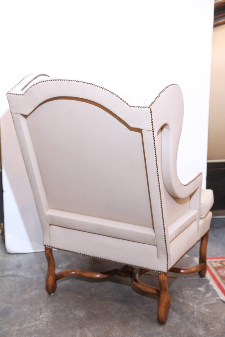Pair Of Mouton Wing Chairs In Off White Leather For Sale