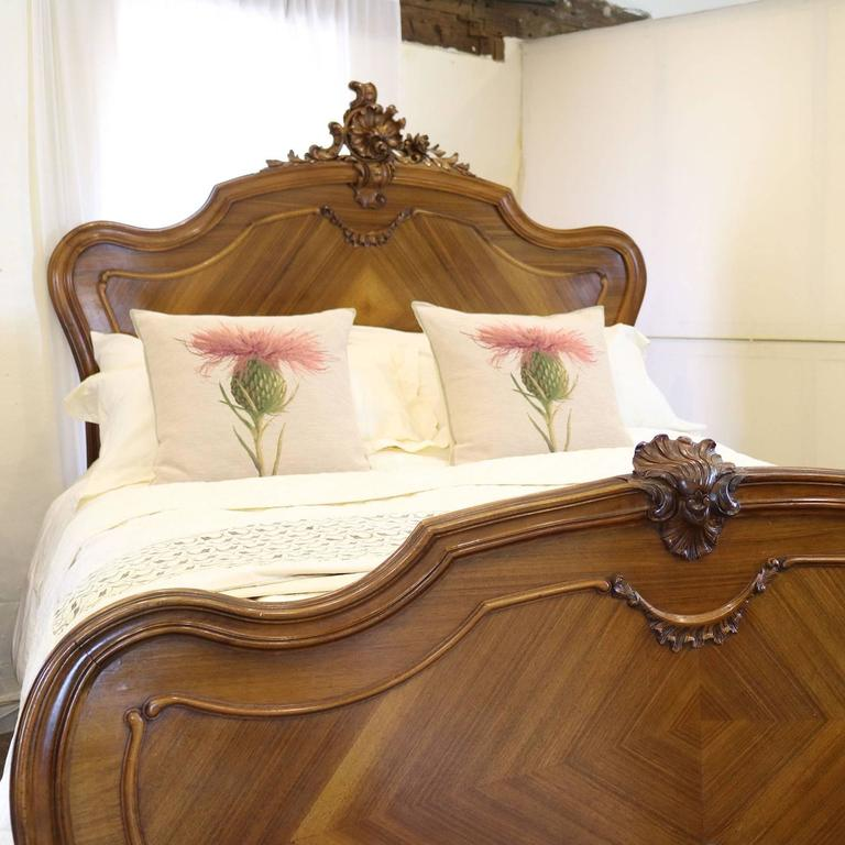 A French Louis XV style bed with ornate carving on the head panel and shaped head and foot boards.  This bed accepts a British king-size or American queen-size (60 in wide) base and mattress set.  The price is for the bed frame alone. The base,