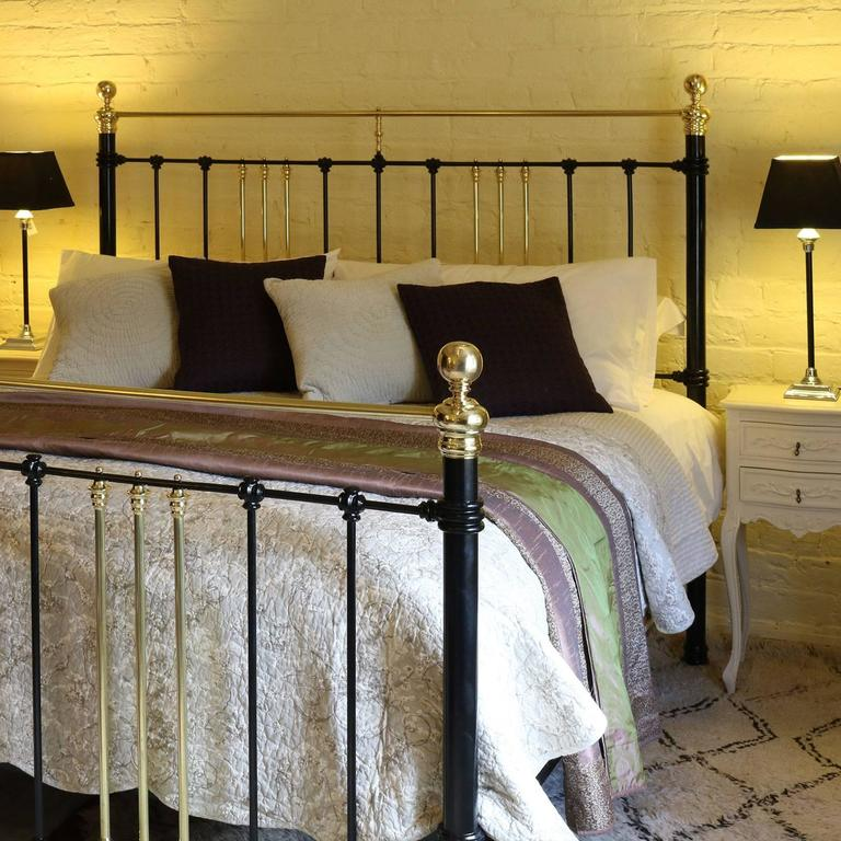 A brass and iron bed finished in black adapted from an original Victorian bed.  This bed accepts a 72 inch wide British super king-size or Californian king-size base and mattress.  The price is for the bed frame alone. The base, mattress, bedding