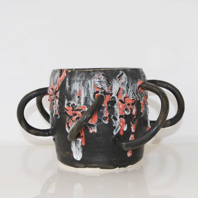 Unique ceramic vessel with multiple glazes by artist Manal Kara.