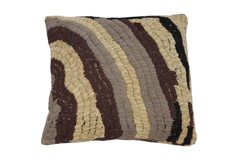 """Floor pillow made with vintage Moroccan textile rug.  This pillow is tan, grey, and dark brown with accent of metallic silver.  Measures: 28"""" L x 27"""" W."""
